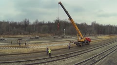 People build railroad with crane on truck at spring day Stock Footage