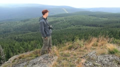 Tourist in the mountains admires views Stock Footage