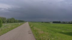 Threatening sky above dike + pan river foreland River Rhine Stock Footage