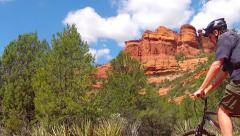 Sedona Mountain Biker Stops To Admire View Rides On Stock Footage