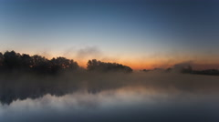 NO BIRDS. The early morning evaporation above water surface of the forest lake - stock footage