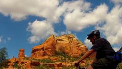 Mountain Biker Through Foreground Of Sedona Red Rock View Stock Footage