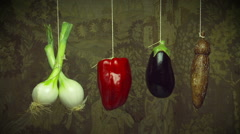 Hanging vegetables swing gently on string Stock Footage