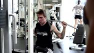 Stock Video Footage of Young Man Uses Lat Machine (training apparatus)