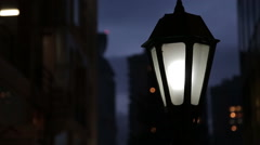 Glowing street lamp - stock footage