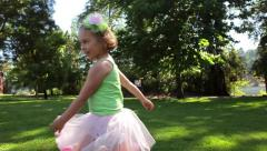Little Girl, In Tutu, Points To Something And Walks Away - stock footage