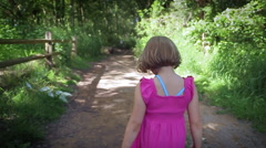 Little Girl Walks Alone Down A Nature Trail Stock Footage