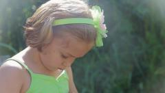 Little Girl Looks Down And Then Up, She Seems Sad Stock Footage
