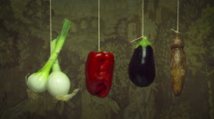 Hanging vegetables  swing & turn  gently on string Stock Footage