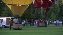 Crowd Watches as Hot Air Balloons Set Off Large Flames Stock Footage