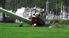 Crash Wreckage Of A Small Plane On Grass Field Next To Marina 4K Stock Footage