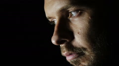 Sad and thoughtful man looks into the camera: troubled, depression, thoughts  Stock Footage