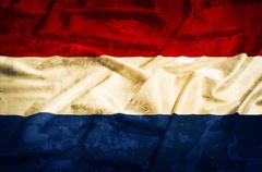 netherland grunge flag on a silk drape - stock photo