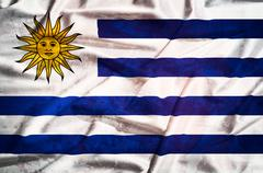 uruguay  grunge flag on a silk drape waving - stock photo
