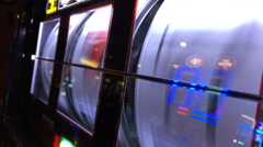 Reels of slot machine spinning at casino Stock Footage