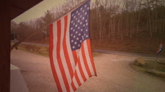 Vintage american flag waving in wind at store Stock Footage