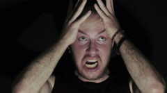 desperate young man in the dark: desperation, loneliness: discomfort, psychosis - stock footage