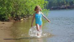 5 Year Old Girl Walks Through Water Close To Shore Stock Footage