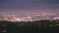 Wide Sunset Over Los Angeles. Night City Lights Transition - stock footage