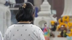 Buddhist woman praying and burning incense, Bangkok Stock Footage