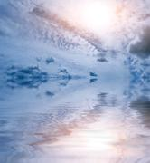 Stock Photo of clouds sun ocean