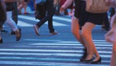 People walking across a busy Japanese intersection in Shibuya, Tokyo Stock Footage
