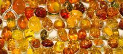 handmade amber rings - stock photo