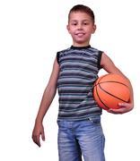 Smiling boy, basketball player posing with a ball Stock Photos