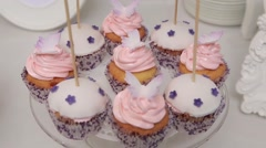 Plate with pink cakes. Close up. Dolly shot. Stock Footage