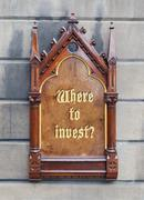 decorative wooden sign - where to invest - stock photo