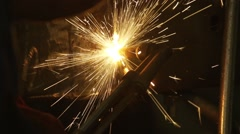 Worker cutting iron, sparks spectacular spread on slow motion Stock Footage