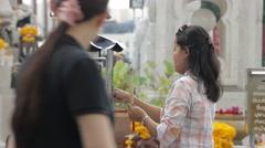 Buddhist woman burning incense, Bangkok Stock Footage