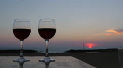 Glasses of red wine at the sunset: dinner, sea, holidays, drinking, alcohol Stock Footage