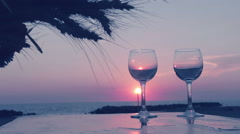 Pouring glasses with wine at the sunset on the beach: summer, holidays Stock Footage
