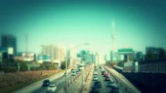 Traffic entering a city. Swing tilt miniature style. Stock Footage