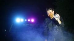 Policeman showing badge show Stock Footage