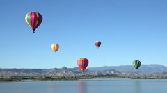 Stock Video Footage of Colorful hot air balloon flight over rural lake 4K 059
