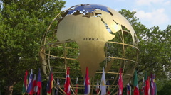 rotating globe and flags - stock footage