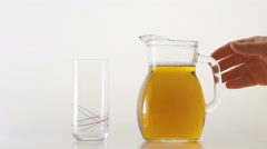 Pouring a glass with ice tea Stock Footage