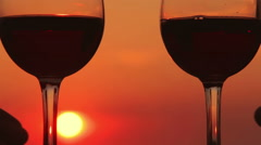Having a toast at the sunset: love, having fun, summer, drinking Stock Footage