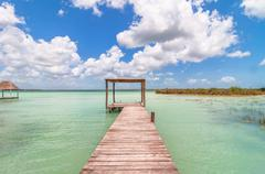 Idyllic pier and palapa hut in Bacalar lagoon in Mexico - stock photo