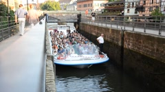 Tourists on the boat exceeds the slope of the dam Strasbourg Stock Footage