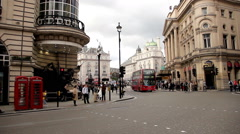 Famous red double-decker and telephone box in London Stock Footage