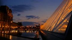 Louvre museum illuminated sunset Stock Footage