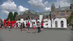 "Tourists take pictures with the word giant in Museumplein ""I am amsterdam"" Stock Footage"