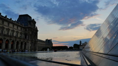 Louvre low angle pyramid sunset Stock Footage