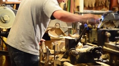 Craftsman shows art of manufacture of the clogs Stock Footage