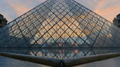 Louvre museum paris low angle sunset Stock Footage