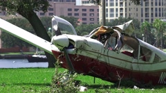 Crash Wreckage Of A Small Plane On Grass Field Close Up 02 4K Stock Footage