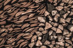 stockpile of sawed logs - stock photo